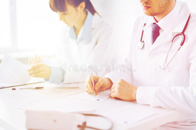 Doctor and nurse writing prescription paper royalty free stock photo