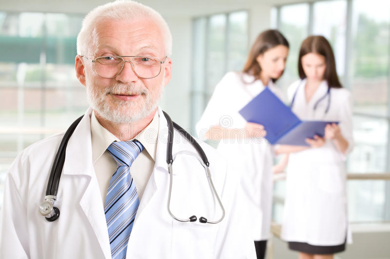 Download Doctor with  nurses stock photo. Image of attractive - 15304800