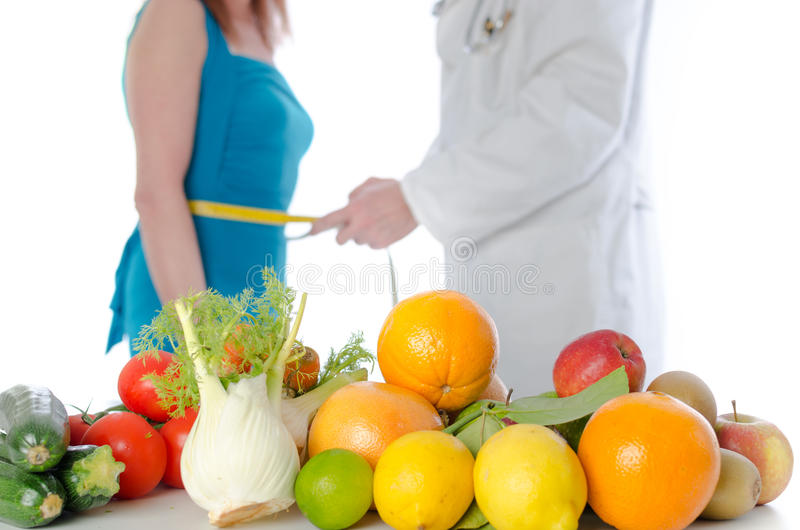 Doctor nutritionist measuring the waist of a patient royalty free stock photos