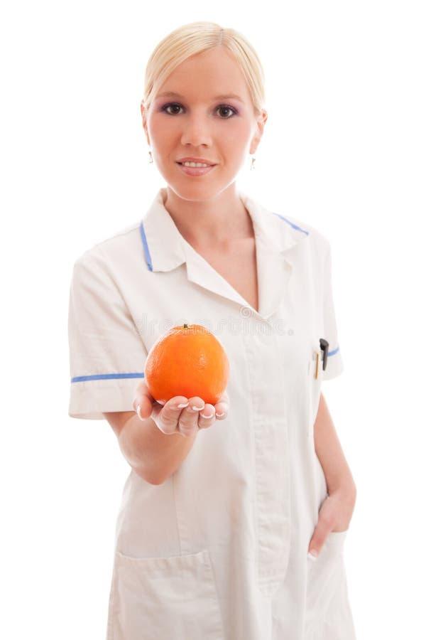 Doctor o enfermera con la naranja fotografía de archivo