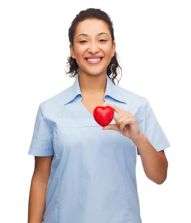Doctor o enfermera de sexo femenino sonriente con el corazón foto de archivo