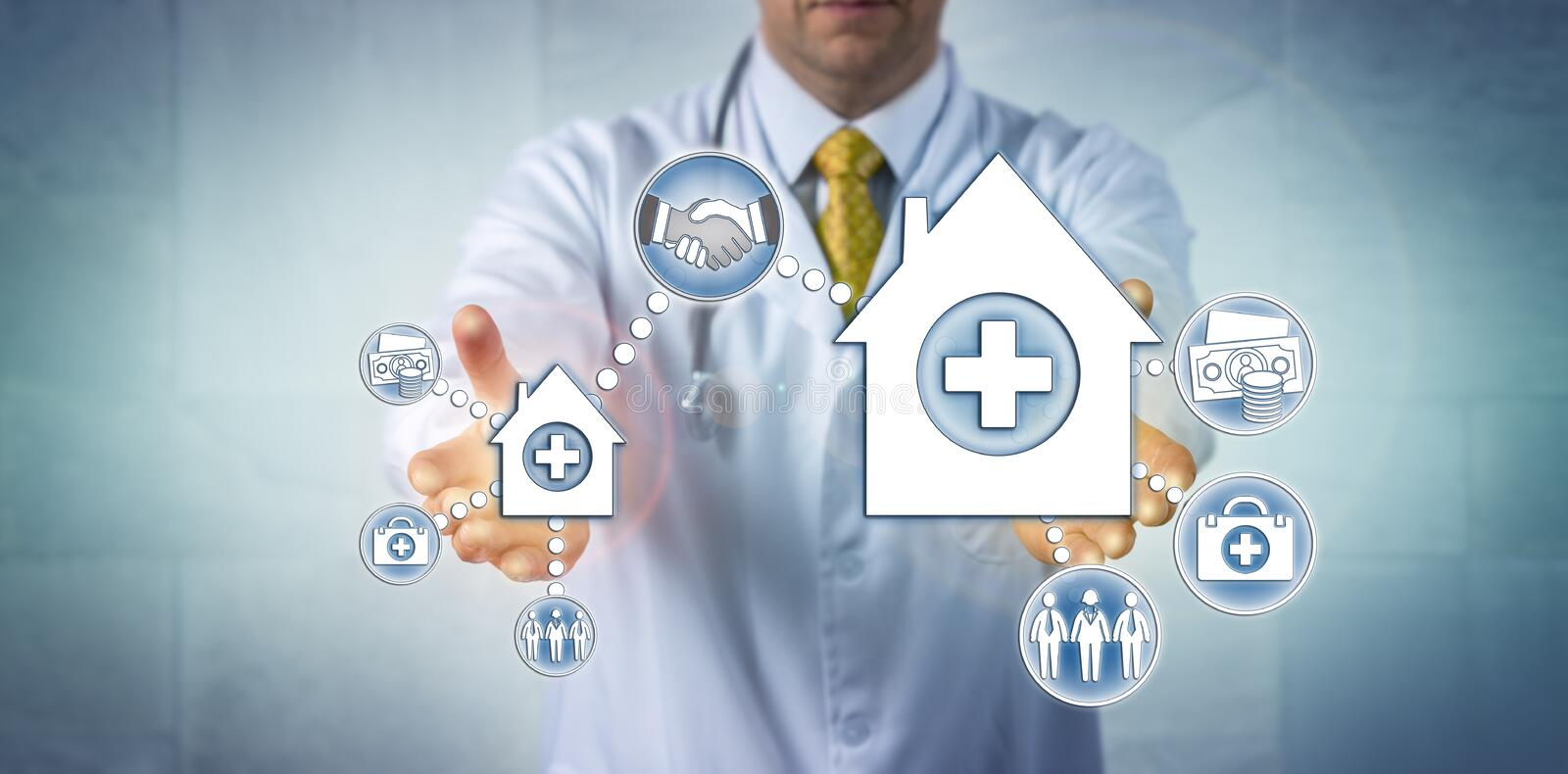 Doctor Offering Merger Of Small And Big Hospital stock photo