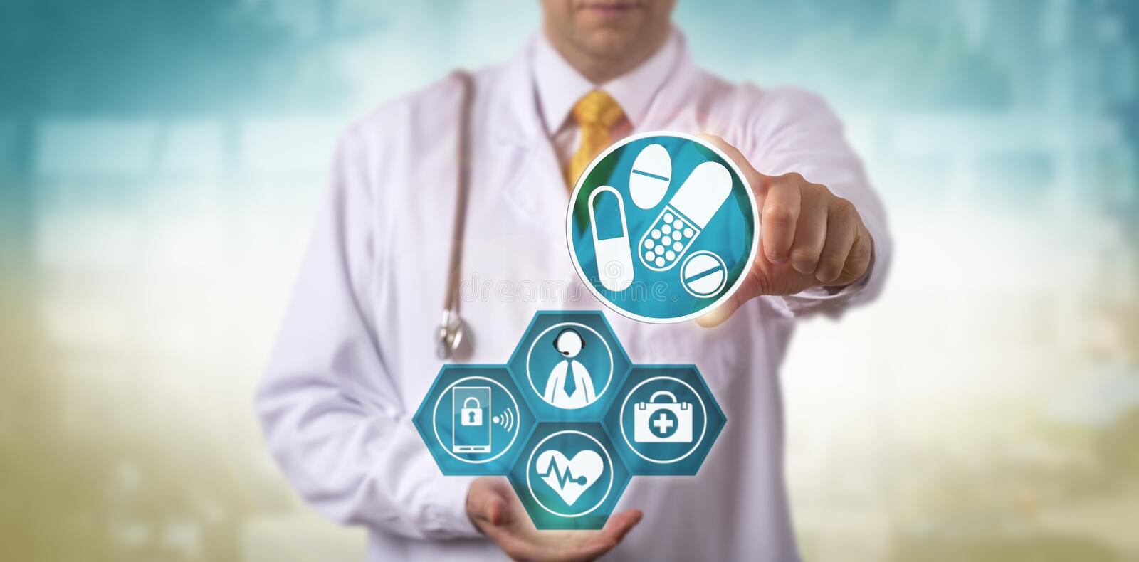 Doctor Offering Telemedicine Prescription Update. Unrecognizable doctor offering a prescription update to a male patient via internet connection and smart phone royalty free stock image