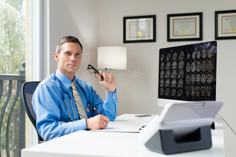 Doctor in Office. Brain Surgeon Doctor in Office royalty free stock photography