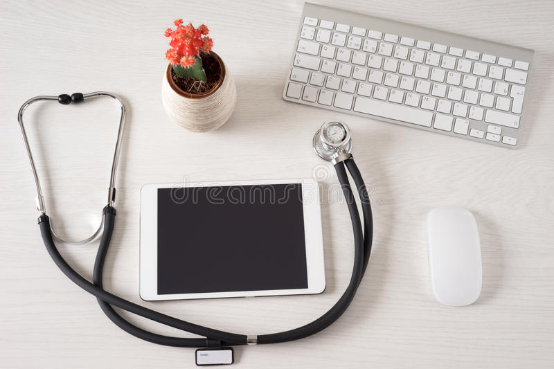 Doctor office. Tablet touch pad computer is in the doctor office royalty free stock image