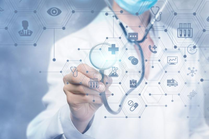 A doctor operating with a medical service composite structure royalty free stock image