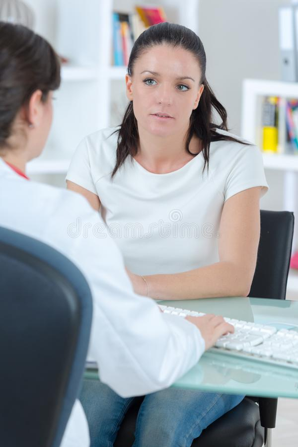 Doctor with a patient stock photo
