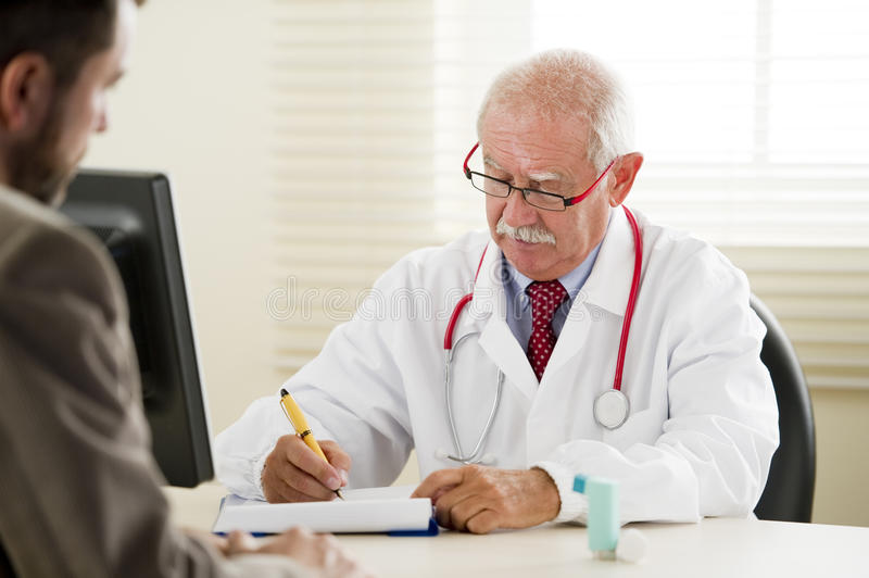 Download Doctor with Patient stock photo. Image of mustache, stethoscope - 16903056