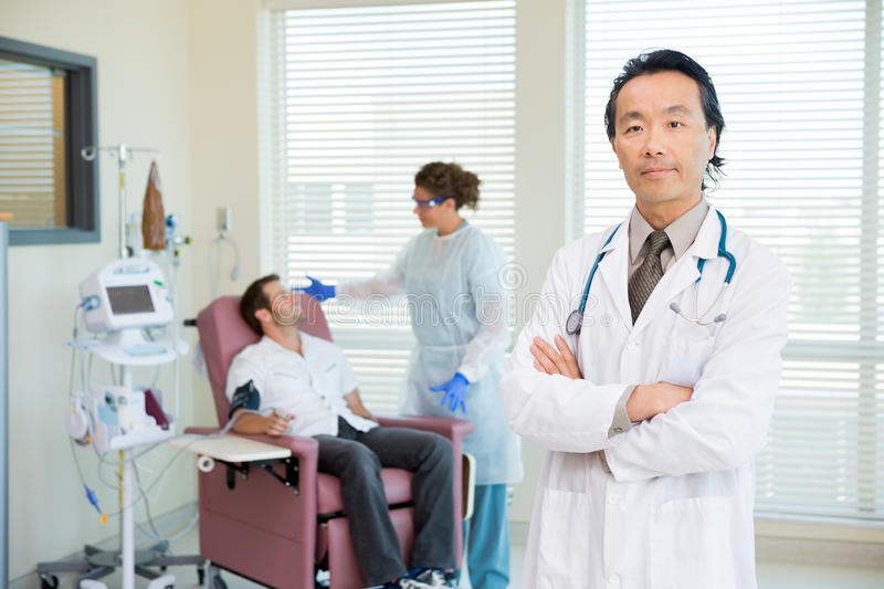 Doctor With Patient Being Examined By Pulse Rate royalty free stock images