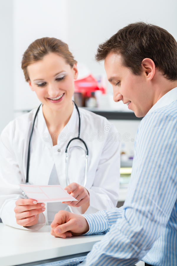 Doctor with patient in clinic consulting. Female doctor with her patient in a consultation in clinic explaining something royalty free stock photos