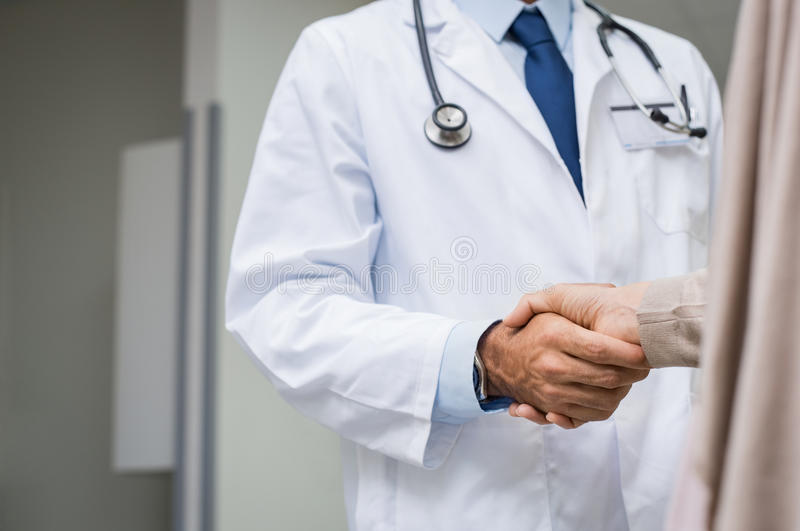 Doctor patient handshake royalty free stock photography