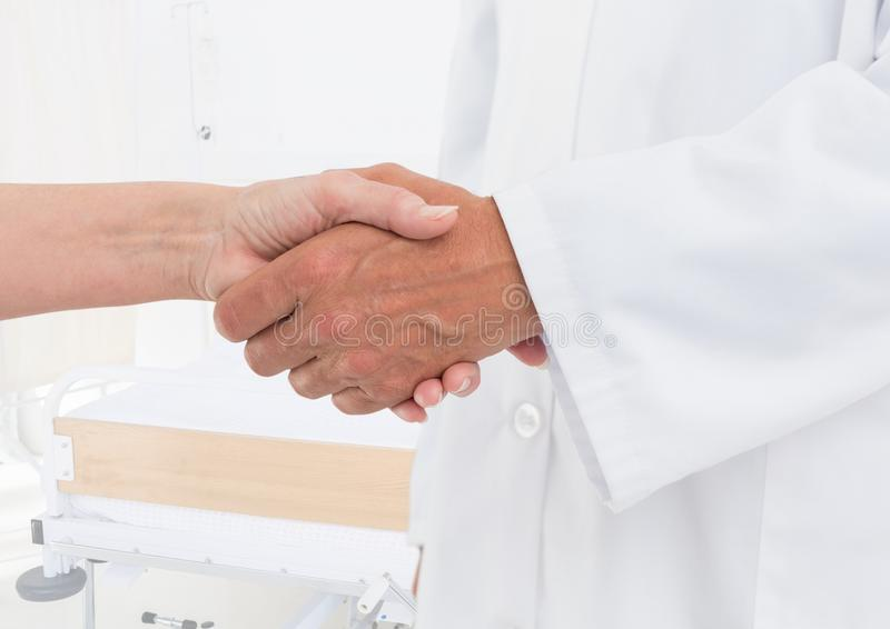 doctor and patient handshake in the hospital stock photos