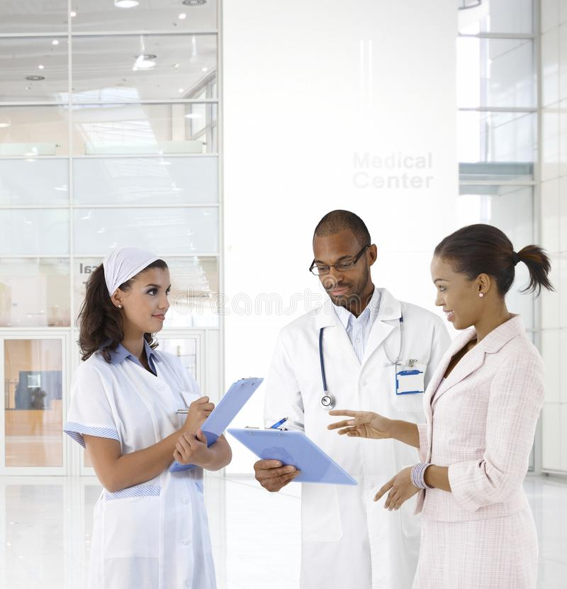 Doctor and patient at medical center. Case discussion at medical center. Doctor, nurse and patient stock images