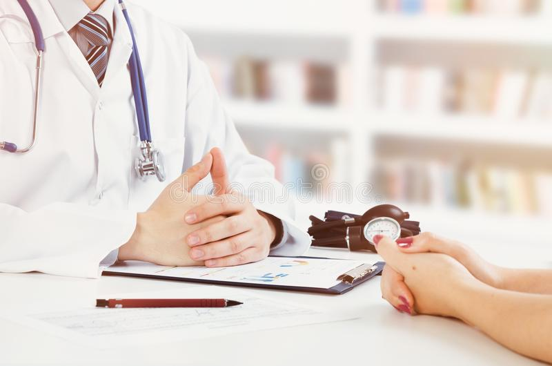 Doctor and patient medical consultation royalty free stock photo