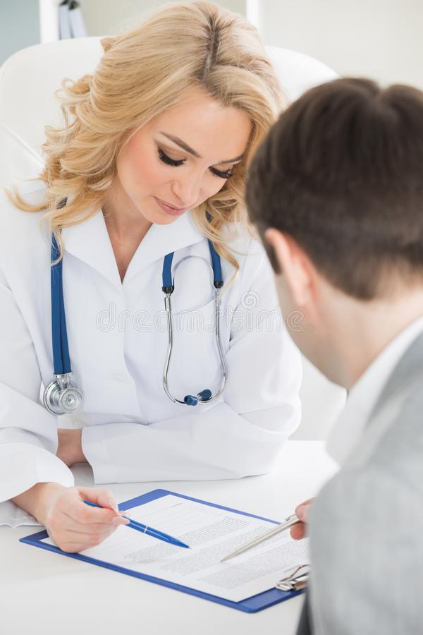 Doctor with patient stock image