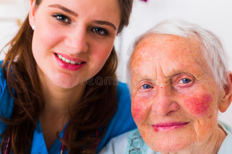 Doctor - patient selfie. Nurse and elderly patient taking a selfie to send it to the relatives to show that everything is going well stock photography