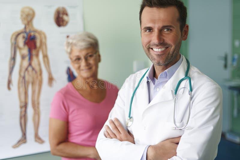 doctor patient smiling arkivbild