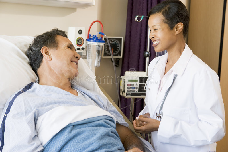 Doctor And Patient Talking To Each Other royalty free stock photo