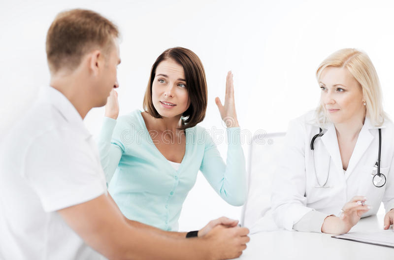 Download Doctor With Patients In Cabinet Stock Image - Image: 39637083