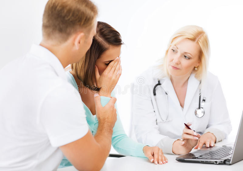 Download Doctor With Patients Looking At Laptop Stock Photo - Image: 33338388