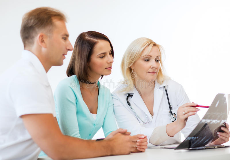 Doctor with patients looking at x-ray royalty free stock photos
