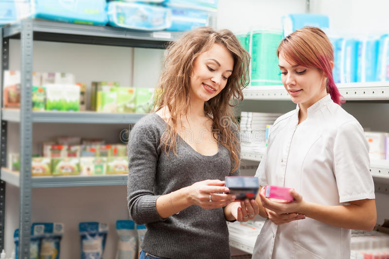 Doctor and pharmacist in the storage facility. Healthcare business stock image