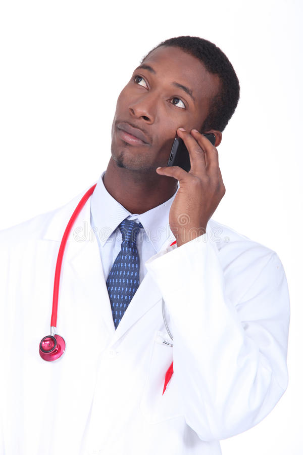 Doctor on the phone. To a patient stock photo
