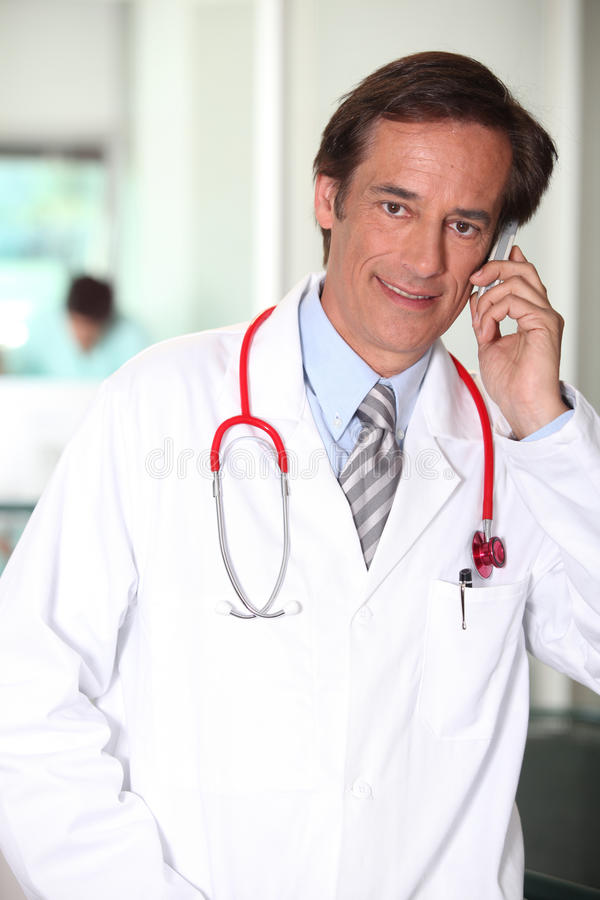 Doctor on the phone royalty free stock photography