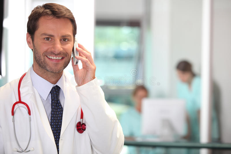 Doctor on the phone. Portrait of a doctor on the phone royalty free stock images