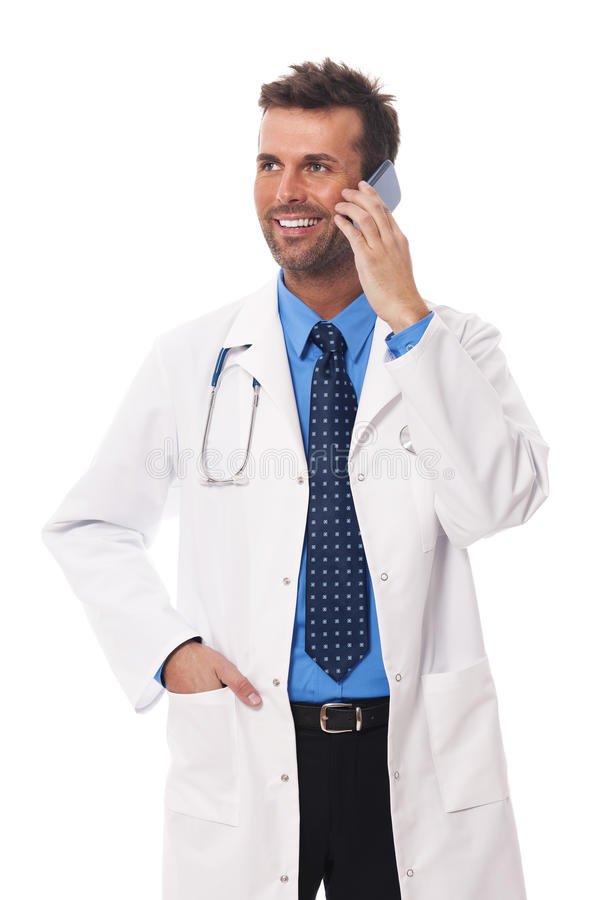 Doctor on the phone. Smiling male doctor talking on mobile phone royalty free stock image