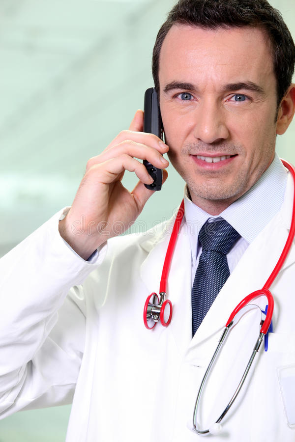 Doctor on the phone stock photos