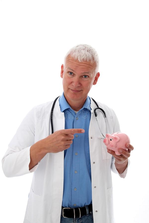 Download Doctor with piggy bank stock photo. Image of isolated - 23977658
