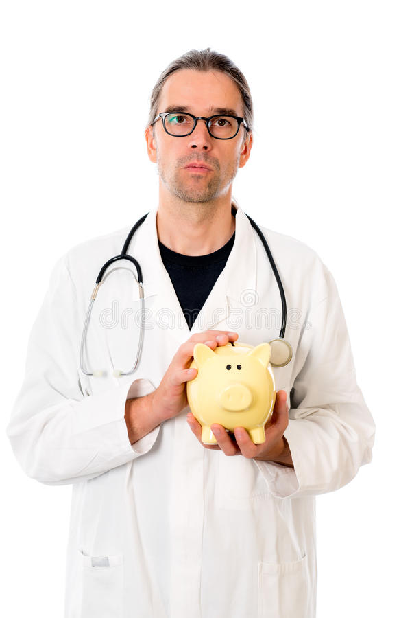 Doctor with piggy bank in lab coat. Doctor with piggy bank in white lab coat stock photos
