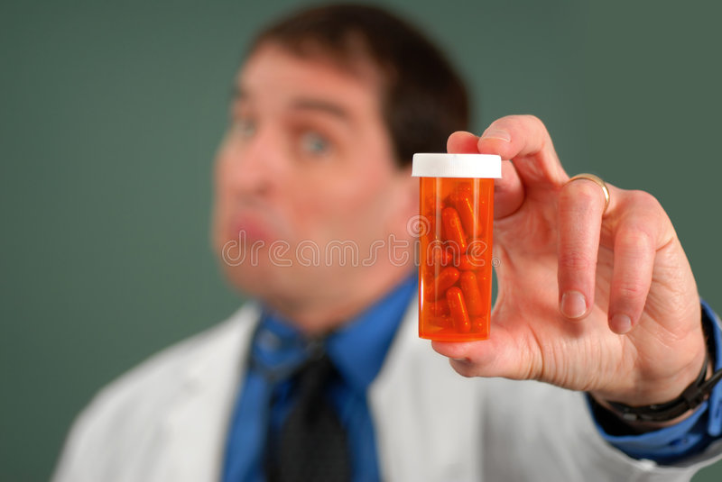 Doctor with Pills stock photography