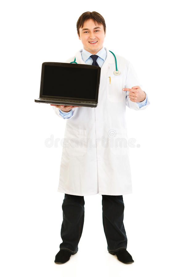 Doctor Pointing Finger On Laptop With Blank Screen Royalty Free Stock Photos