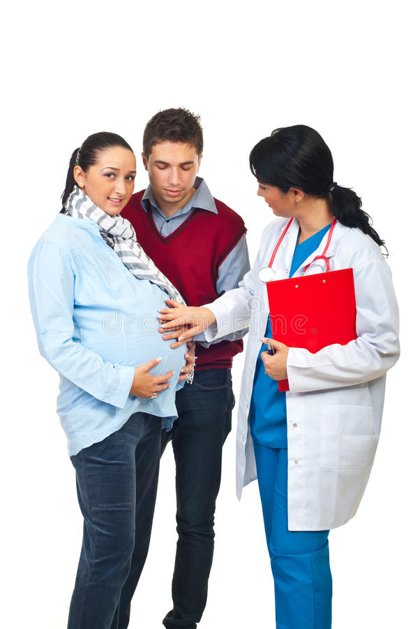 Doctor and pregnant couple royalty free stock image