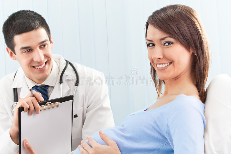 Doctor and pregnant patient stock photo