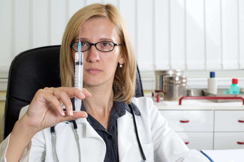 Doctor Preparing Syringe For Vaccination in Clinic royalty free stock photography