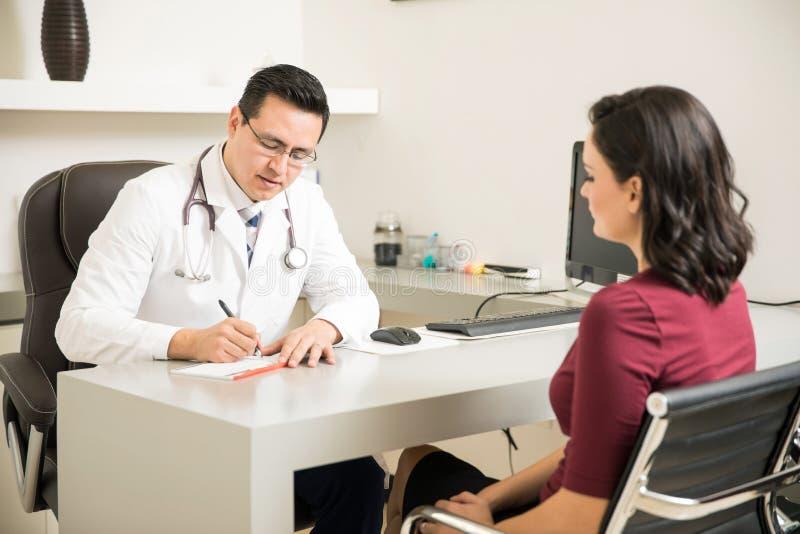 Download Doctor Prescribing Some Medicine To Patient Stock Image - Image: 83707475