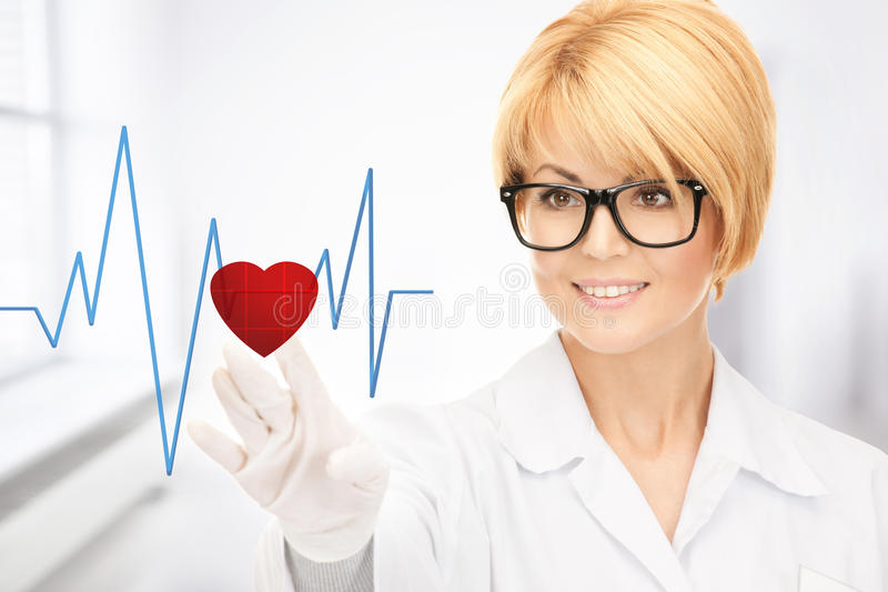 Doctor pressing virtual button with heart diagram. Picture of attractive doctor pressing virtual button with heart diagram royalty free stock photo