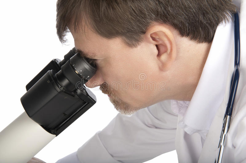 Doctor and Professional Microscope. Close-up of Doctor looking through a Professional microscope isolated on white stock photos