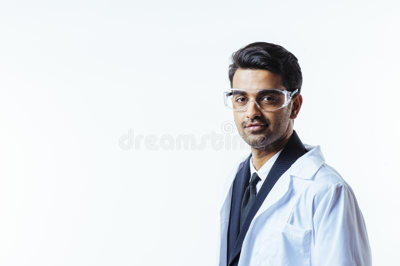 Doctor with protective glasses looking at camera royalty free stock images