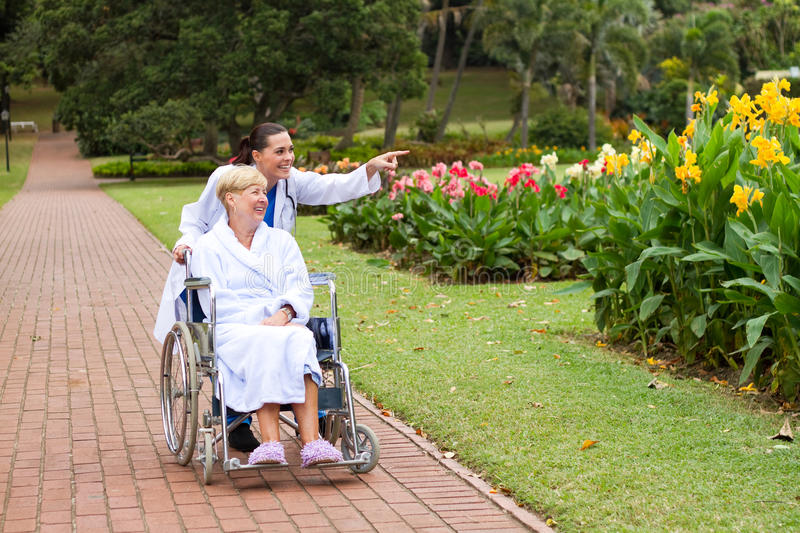 Download Doctor Pushing Wheelchair Patient In Park Stock Image - Image of disabled, nurse: 14219395