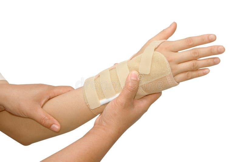 Doctor putting wrist brace stock photo