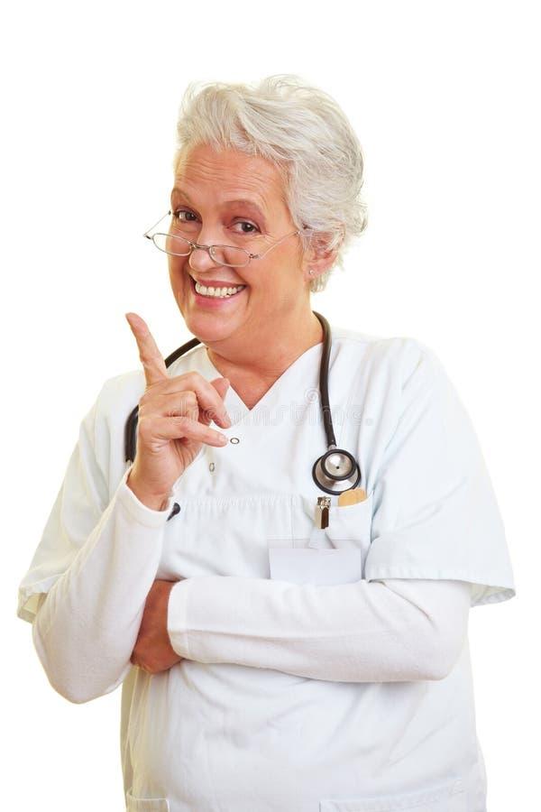 Doctor que sacude su dedo índice imágenes de archivo libres de regalías