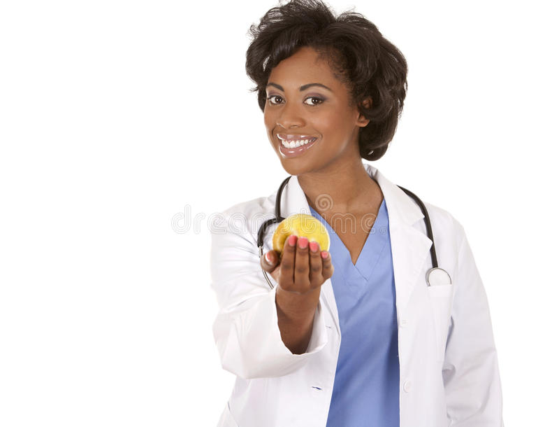 Doctor que sostiene una manzana fotos de archivo
