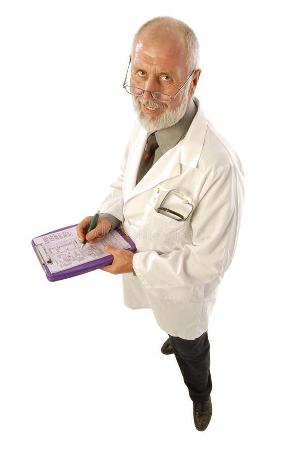 Doctor que toma notas imagen de archivo libre de regalías