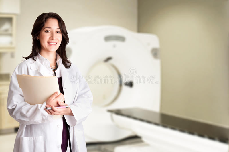 Doctor radiologist at CT CAT scan with chart stock photos