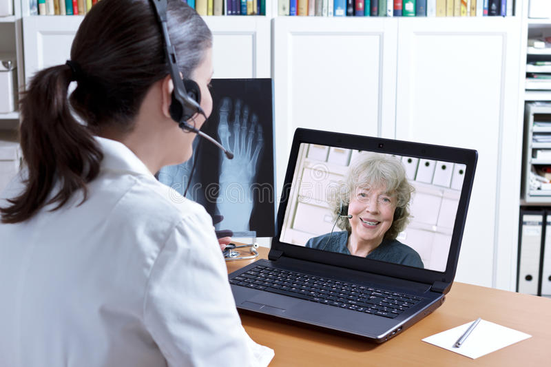 Doctor x-ray laptop patient telehealth stock image