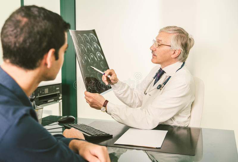 Doctor with x-ray plate stock image